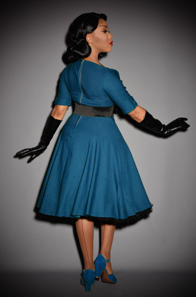 The Teal Delores Dress is a darling 1950's inspired swing dress by Unique Vintage at UK stockists, Deadly is the Female. The Teal Delores Dress is a show stopper! Add a Petticoat and seamed stockings to turn heads in this striking swing dress, where ever you go! Perfect for pin ups and retro style lovers.