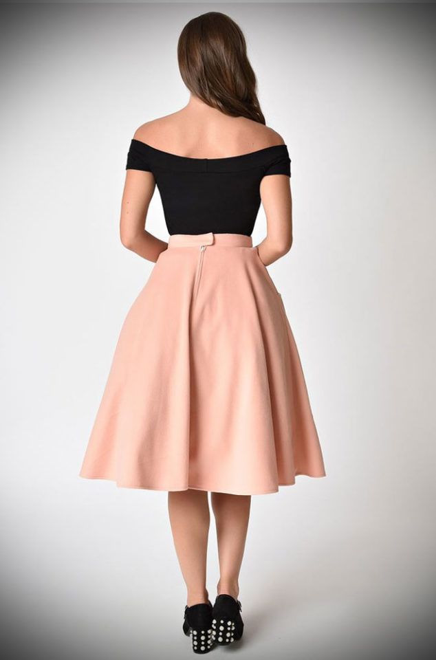 This retro skirt features a high waist with a fitted waistband and a full skirt. Whether it is worn with or without a petticoat, the 50's Soda Shop Poodle Skirt has a fabulous mid-century silhouette. Ever since I was a little girl, I've been obsessed with Poodle skirts so there was no way we could resist this skirt!
