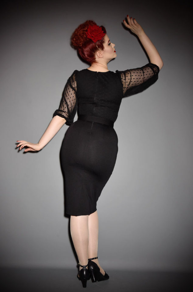 The Frenchie Wiggle Dress is a classic LBD. It has beautiful 1930's style bishop sleeves, paired with a tie neck detailing & fused strapless bodice. Inspired by vintage designs & details, this dress will quickly become your go to style. Deadly is the Female are official UK stockists of Vixen by Micheline Pitt.