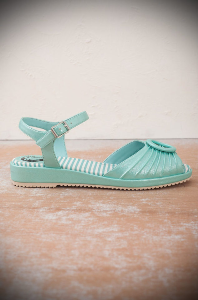 The Miss L Fire aqua Adrianna sandals are 1940's style mini-wedge sandals. This casual shoe has been given a fun and glamorous edge with the striking silver sparkles. Perfect for pairing with your favourite summer dress and idea with some 50's style jeans or capris!