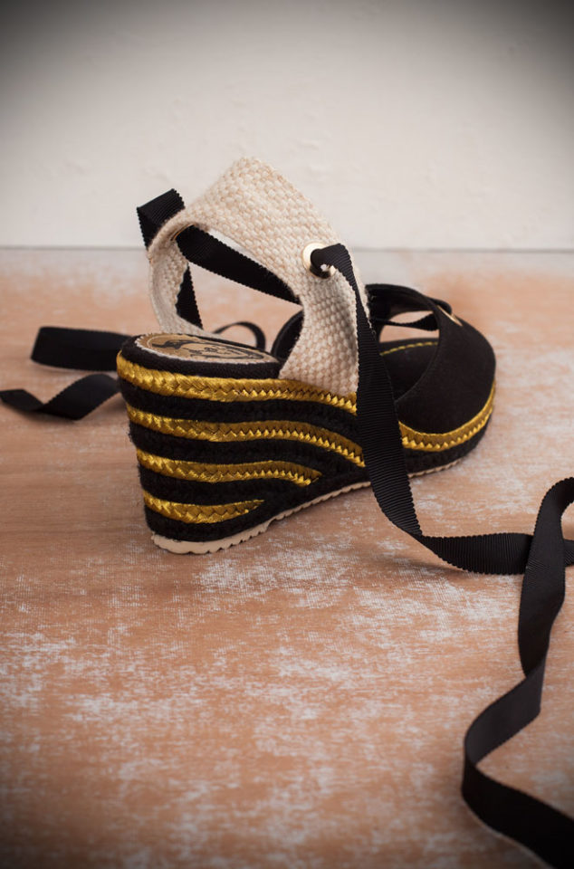 The Miss L Fire Martha Sandals are wedge heeled sandals. Featuring a woven black and gold heel, these fantastic vintage inspired shoes are to die for. They feature a tie up ankle strap and peep toe. These pretty shoes are perfect for pairing with your favourite summer dress or 50s style capris!