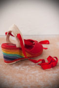 The Miss L Fire rainbow Martha Sandals are wedge heeled sandals. Featuring a gorgeous woven rainbow heel, thesefantastic vintage inspired shoesare to die for. They feature a tie up ankle strap and red peep toe. These pretty shoes are perfect for pairing with your favourite summer dress or50s style capris!