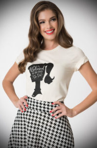 "This official She Believed She Could Barbie T shirt in collaboration with Unique Vintage is just darling. A black screen print on front showcases the iconic Barbie silhouette logo with a joyful font that reads, ""She Believed She Could So She Did""."