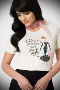 "This official Classic Barbie T shirt in collaboration with Unique Vintage is just darling. This chic tee reads ""A Classic Never Goes Out Of Style"". Stunning artwork showcases the iconic Barbie ensemble, 'Solo in the Spotlight' on the front."