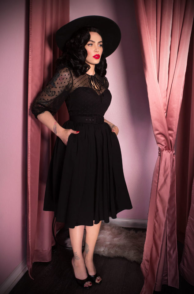 TheFrenchie Swing Dress is a classic LBD. It has beautiful 1930's style bishop sleeves, paired with a tie neck detailing & fused strapless bodice. Inspired by vintage designs & details, this dress will quickly become your go to style. Deadly is the Female are official UK stockists of Vixen by Micheline Pitt.