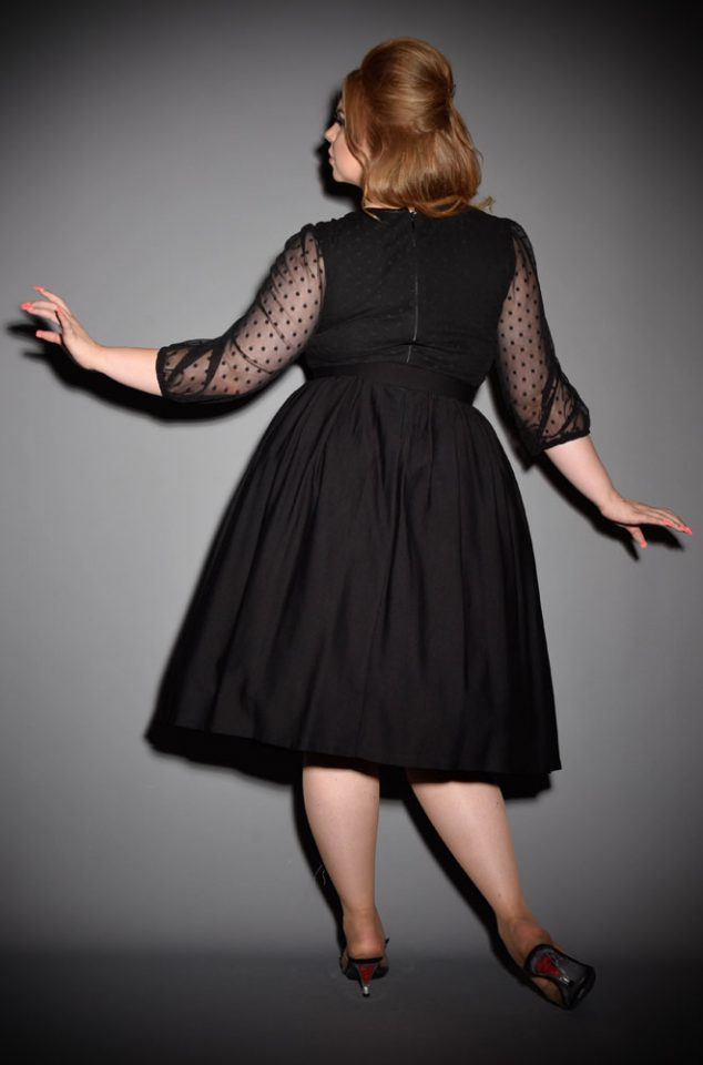The Frenchie Swing Dress is a classic LBD. It has beautiful 1930's style bishop sleeves, paired with a tie neck detailing & fused strapless bodice. Inspired by vintage designs & details, this dress will quickly become your go to style. Deadly is the Female are official UK stockists of Vixen by Micheline Pitt.