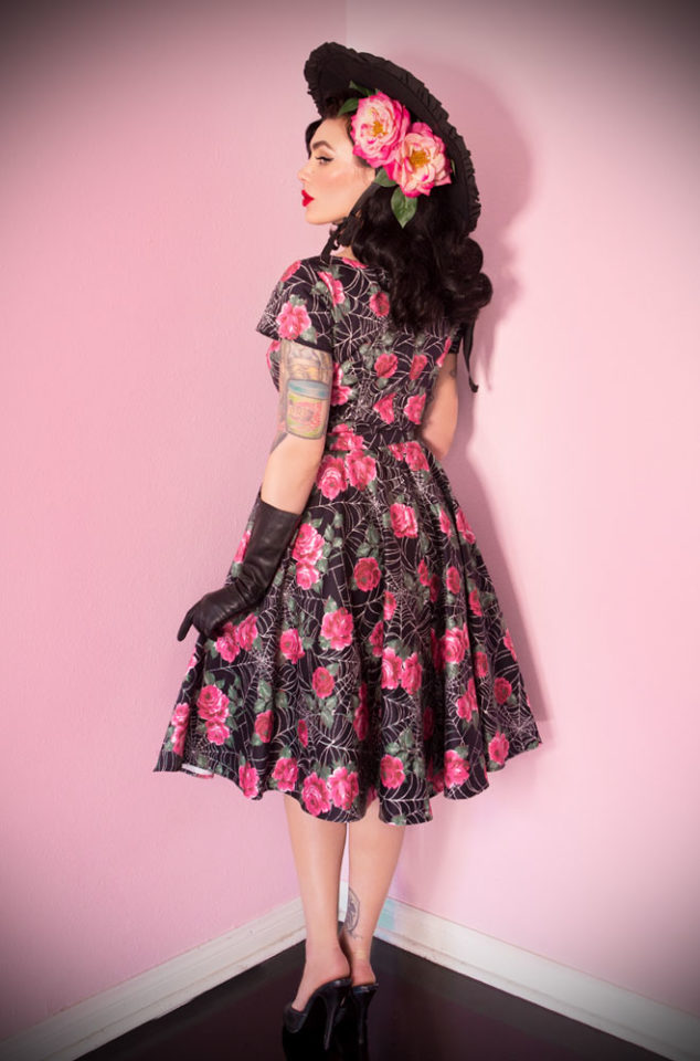 The Vixen by Micheline Pitt Spider Web Vanity Fair Dress is a stunning 50's style floral and web swing dress. As always with Vixen, this dress is high quality and the perfect blend of classy and sassy. It is the ultimate sexy house dress in a vintage rose and web print. Available at UK stockists - Deadly is the Female.