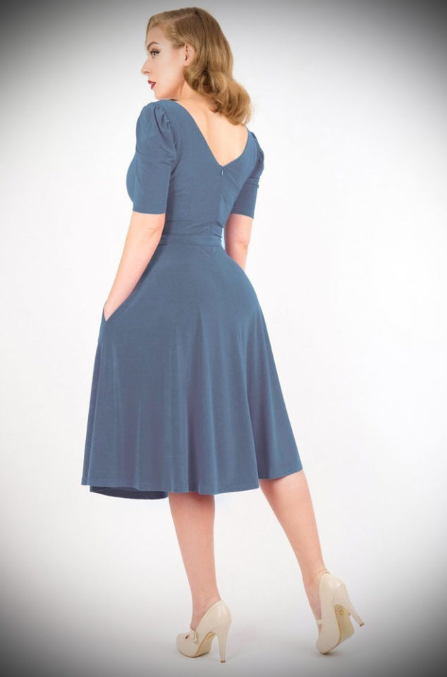 The Natalie Swing Dress features puff sleeves, plunging neckline and v-back. There is a matching belt to cinch the waist and accentuate your curves too. Midi length skirt with front pleats and our favourite feature - pockets! Crafted from a soft, stretch fabric for a luxurious and comfortable fit.