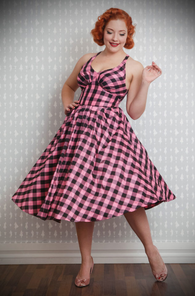 The Brigette-Lou Swing Dress is a chic 50's style dress in pink and black gingham taffeta. Perfect for an instant vintage style, especially when worn with a petticoat. This dress is Limited Edition. This dress is Limited Edition. Deadly is the Female are UK stockists of Miss Candyfloss.