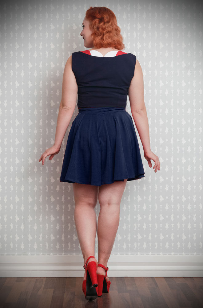 The Navy Paola Culotte Shorts are gorgeous and comfortable 1940's styled mid-thigh length pleated shorts in stretch fabric. They are the perfect way to add some effortless retro style to your everyday look! Available at Miss Candyfloss at UK stockists, Deadly is the Female.