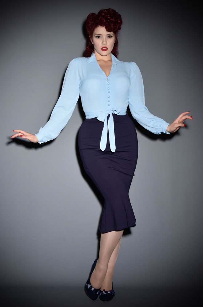 The Powder Blue Clarice Blouse is a classic 40's inspired blouse. Wear theClarice Blouse with high waisted trousers for a chic daytime look or a pencil skirt, seamed stockings and heels for a glamorous 40s style.