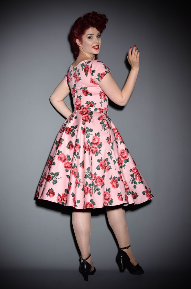 The Vixen by Micheline Pitt Vintage Rose Vanity Fair Dress is a stunning 50's style floral swing dress. As always with Vixen, this dress is high quality and the perfect blend of classy and sassy. It is the ultimate sexy house dress in a vintage rose print. Available at UK stockists - Deadly is the Female.