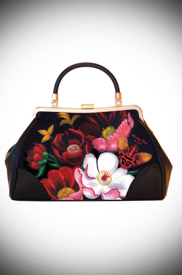The Glorious Vintage Style Handbag features artwork by Woody Ellen. It is a classic vintage shape bag with stunning floral artwork. Available now at UK stockists Deadly is the Female.