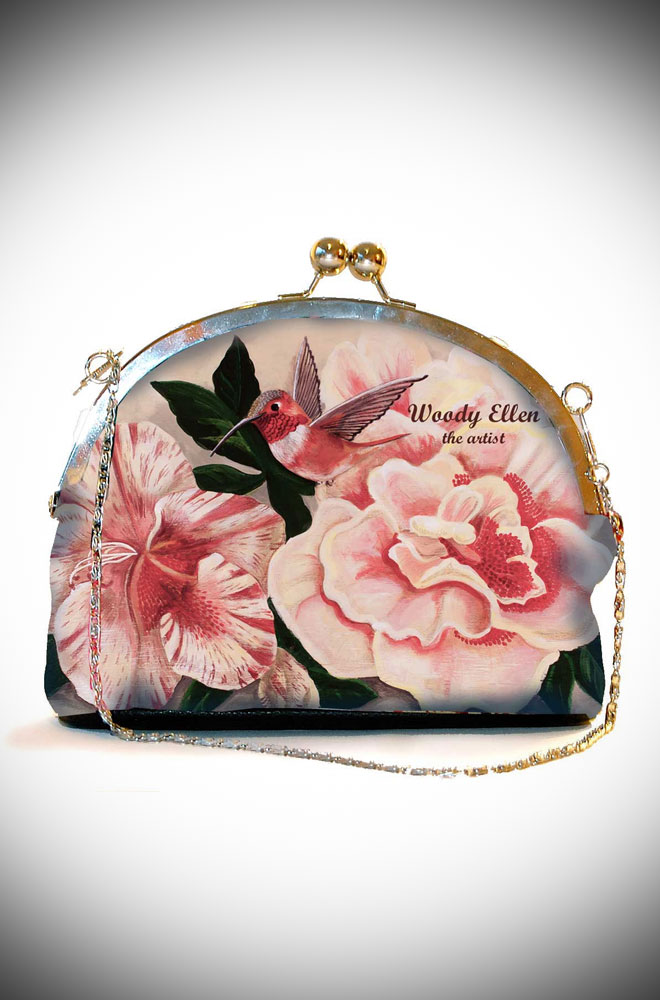The Honeybird Woody Ellen Clip Bag features romantic oversized roses on a pale pink background. Available now at UK stockists, Deadly is the Female