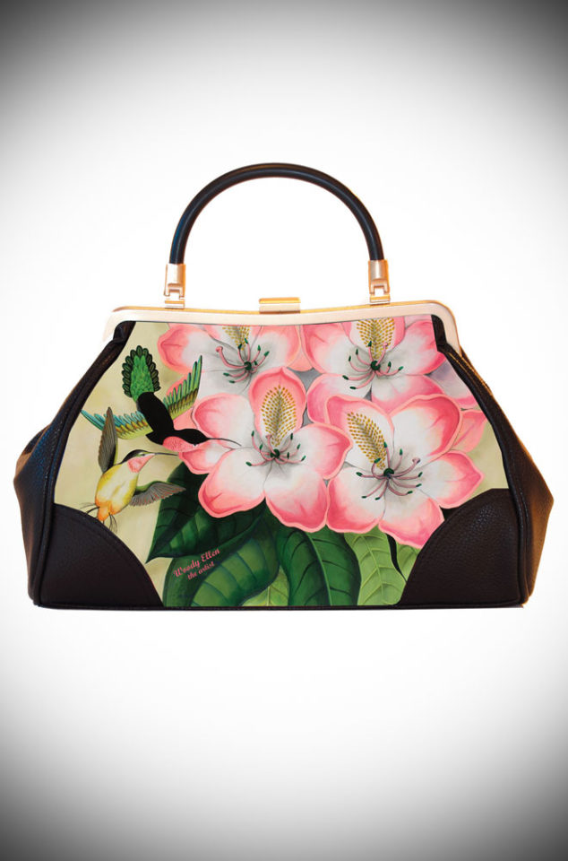 The Libre Vintage Style Handbag features artwork by Woody Ellen. It is a classic vintage shape bag with stunning floral artwork. Available now at UK stockists Deadly is the Female.