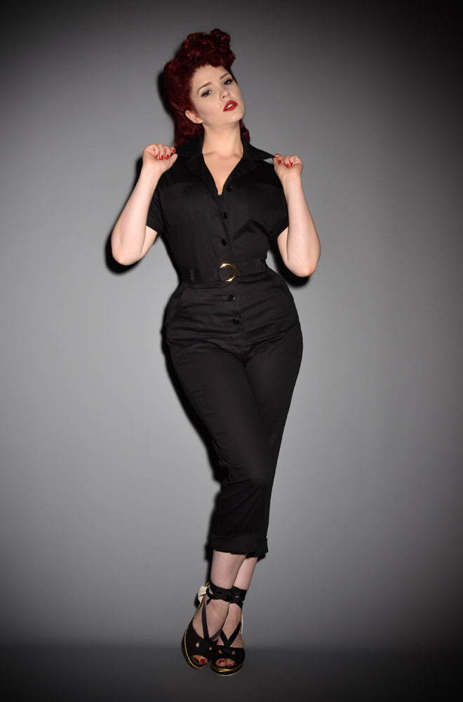 The 1950s Glamourall Jumpsuit is fabulously saucy while incredibly wearable! Effortlessly add some vintage style to your everyday look with these sassy black overalls. Available now at DeadlyistheFemale.com