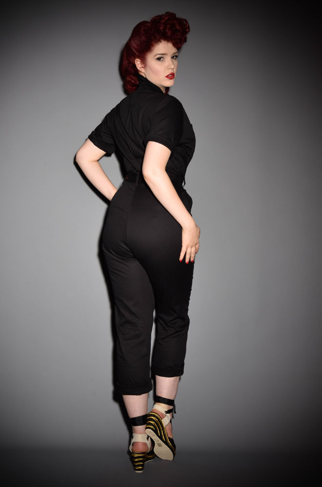 The1950s Glamourall Jumpsuit is fabulously saucy while incredibly wearable! Effortlessly add some vintage style to your everyday look with these sassy black overalls. Available now at DeadlyistheFemale.com