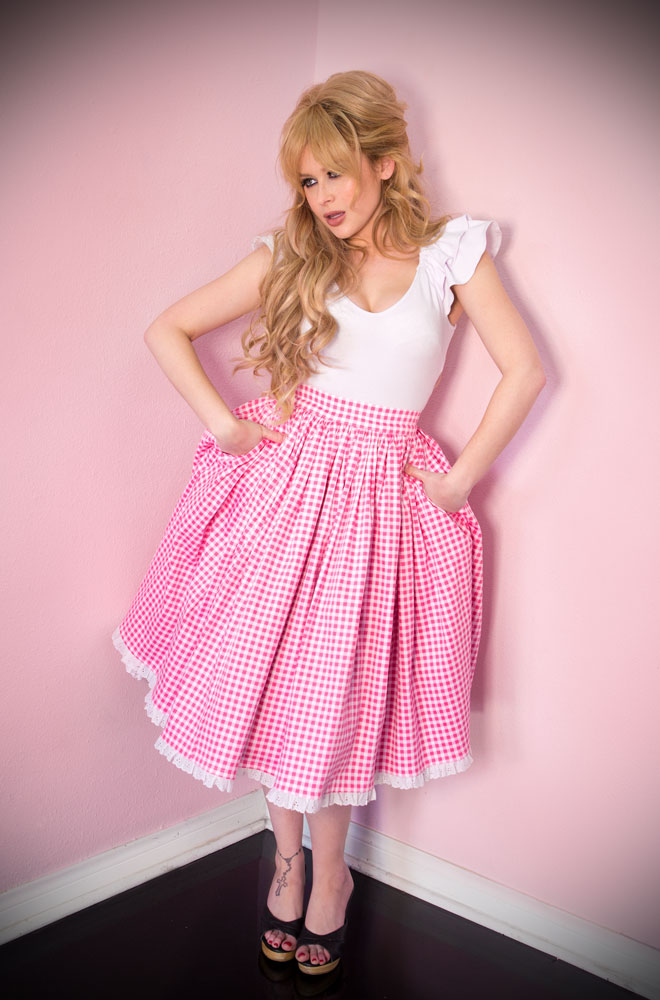 The Pink Gingham Vixen Swing Skirt has arrived at Deadly is the Female, official UK stockists of Vixen by Micheline Pitt. The new and limited edition gingham is inspired by the iconic style of Bardot.