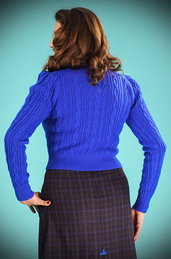 This stunning 40's Cobalt Blue Ice Skater Cardigan by Emmy Design is a beautiful wardrobe essential. The vibrant blue colour is flattering to all skin tones! DeadlyistheFemale.com are official UK stockists of Emmy Design Sweden.