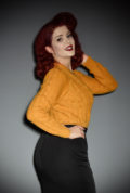 This stunning 40's Mustard Ice Skater Cardigan by Emmy Design is a beautiful wardrobe essential. The Mustard colour is cheerful and flattering to all skin tones, it is sure to brighten your day! DeadlyistheFemale.com are official UK stockists of Emmy Design Sweden.