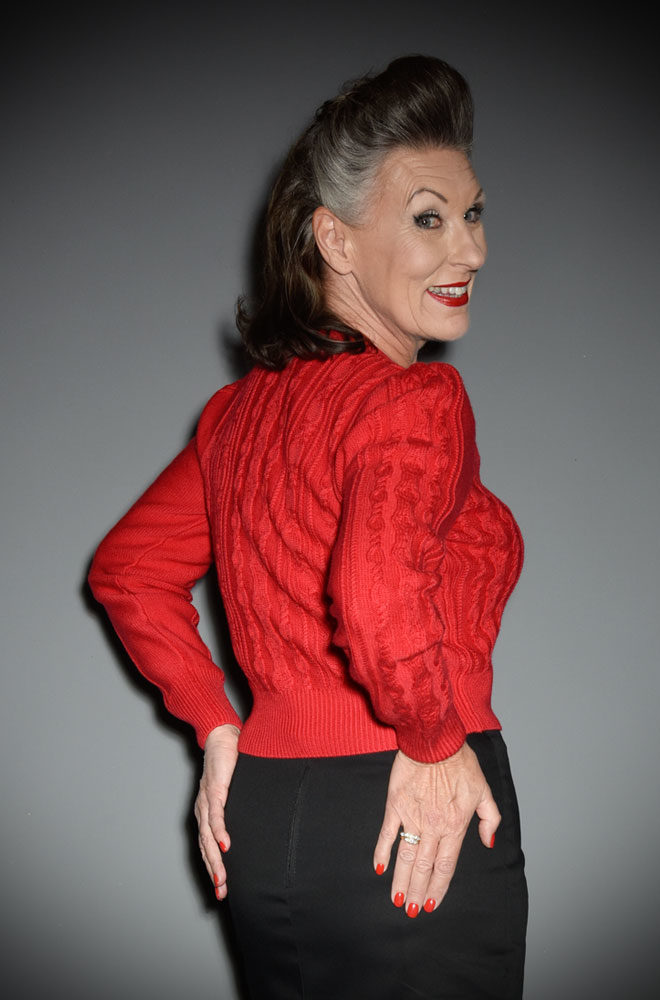This stunning 40's Lipstick Red Ice Skater Cardigan by Emmy Design is a beautiful wardrobe essential. The lipstick red colour is cheerful and flattering to all skin tones, it is sure to brighten your day! DeadlyistheFemale.com are official UK stockists of Emmy Design Sweden.