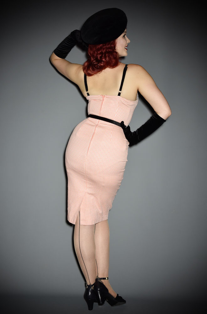 The Limited Edition Peach Gingham Lilli Wiggle dress a chic sweetheart pencil dress designed by Micheline Pitt for Unique Vintage. Deadly is the Female are official stockists of this highly sought after collaboration.