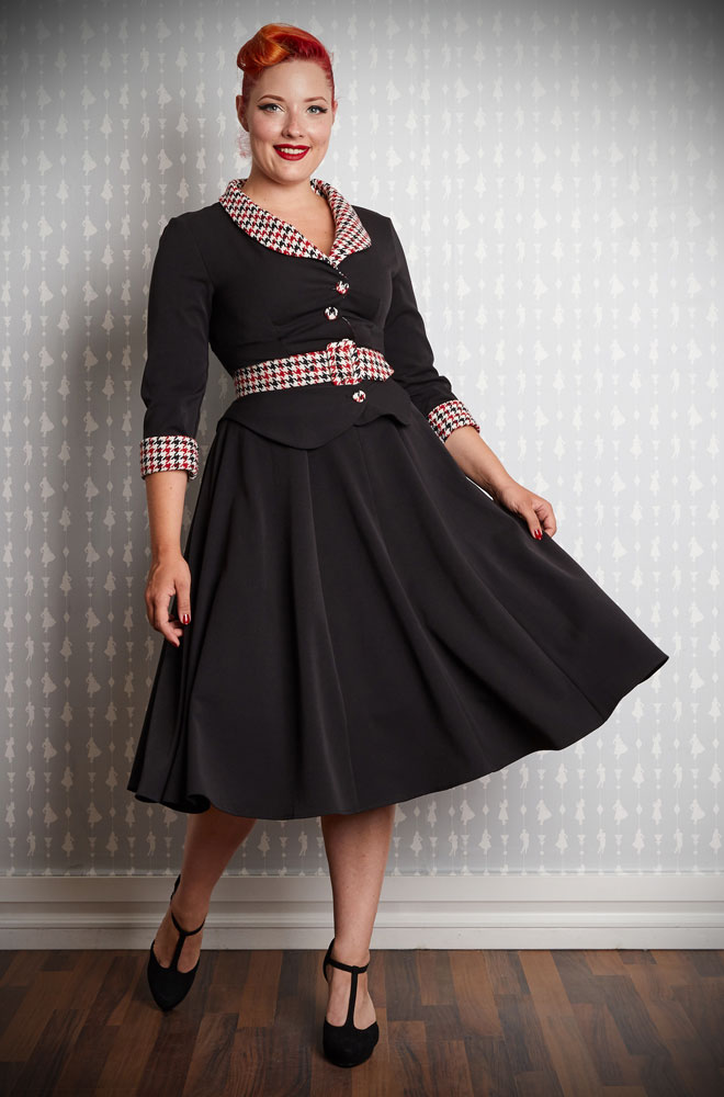 The houndstooth and timeless black Adalaide-Lou Swing Dress is perfect for an effortless daytime look. This dress can also easily be dressed up for evening soirées, just add heels and a petticoat! By Miss Candyfloss at UK stockists, Deadly is the Female.