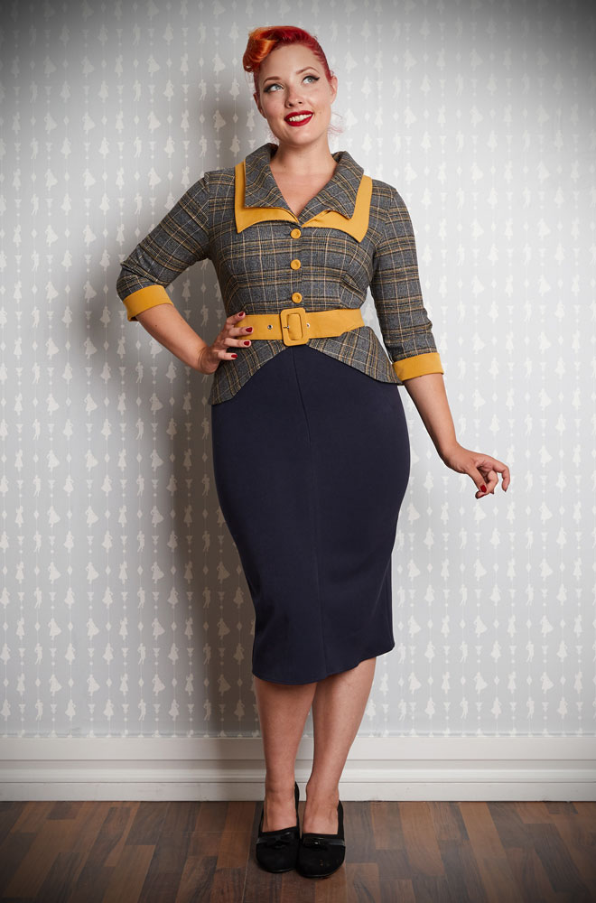 The Inaya-Lee Tailored Pencil Dress is a chic pencil dress in navy and mustard. Perfect for an effortless daytime look that is sure to turn heads. This dress can also easily be dressed up for evening soirees, just add heels! Created by Miss Candyfloss at UK stockists, Deadly is the Female.