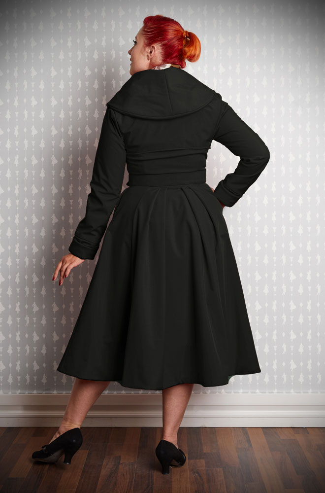 The Myriam-Lou Water Resistant Swing Coat is a stunning 1950's black trench coat. It has been  transformed into an autumn coat with fleece and satin lining. This chic coat is vintage style at it's very best.
