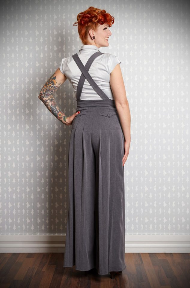 The Nina 1940's Dungarees are chic and stylish. Cut in a soft grey these dungarees can be dressed up or down and are sure to be a wardrobe essential! Featuring a very wide leg & pleats for a flattering fit. Created by Miss Candyfloss at UK stockists, Deadly is the Female.