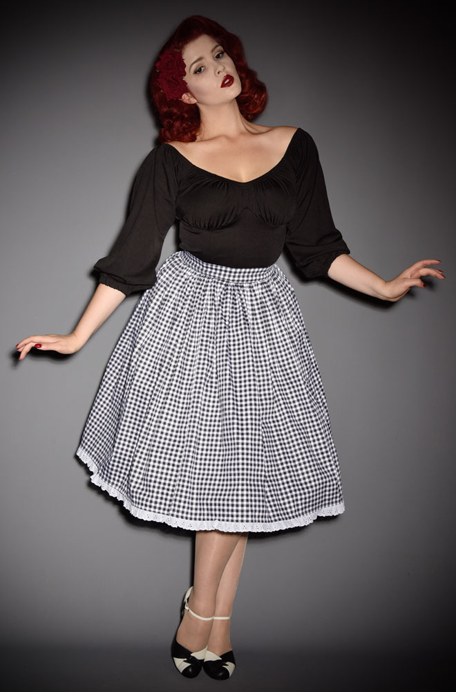 The Black Gingham Vixen Swing Skirt has arrived at Deadly is the Female, official UK stockists of Vixen by Micheline Pitt. The new and limited edition gingham is inspired by the iconic style of Bardot.