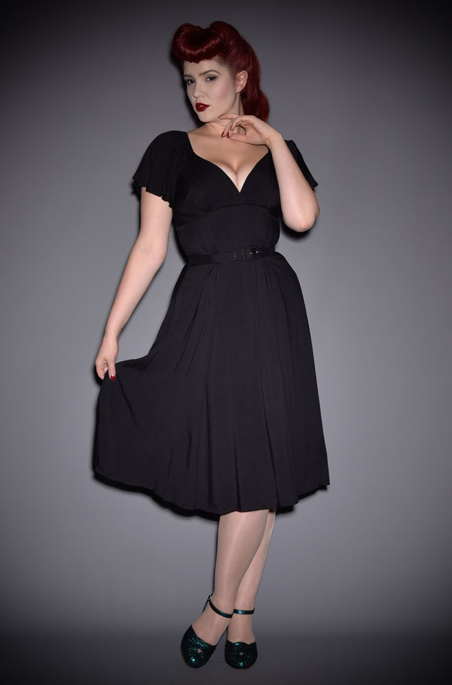 The Black Babydoll Dress has arrived at Deadly is the Female. This dress is both sexy and chic. This striking dress is inspired by flowing 1940's silhouettes and is designed to be cool even in hot climates. DeadlyistheFemale.com are official UK stockists of Vixen by Micheline Pitt. Good things for bad girls.