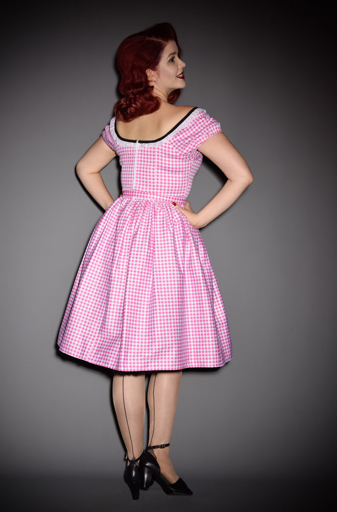 The Pink Gingham Bardot Dress is the ultimate peasant dress! Inspired by the iconic style of Bardot. Deadly is the Female are official UK stockists of Vixen by Micheline Pitt. Good things for bad girls.
