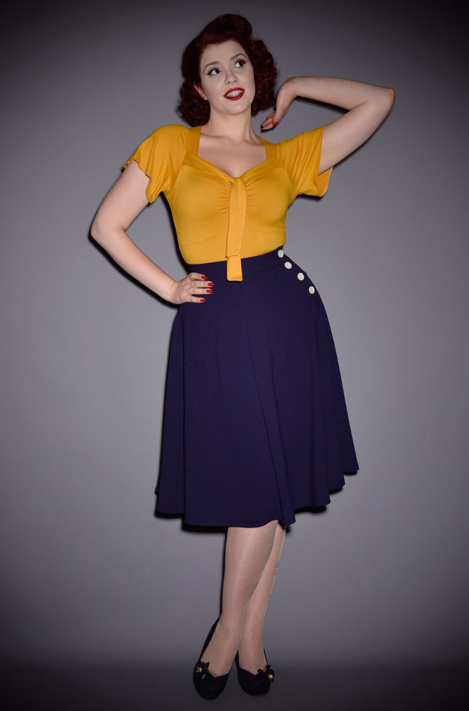 We are so excited about the graceful 40s Whirlaway Skirt! It is so versatile and will take you from work to the dance floor with ease! Pair it with a blouse and seamed stockings for a classic look or opt for some jersey for a more contemporary twist.