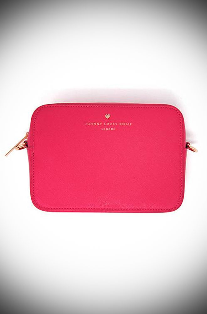 The Hot Pink Crossbody Bag will take you from day to evening in sassy style! This little bag is a great size balancing practicality with style.
