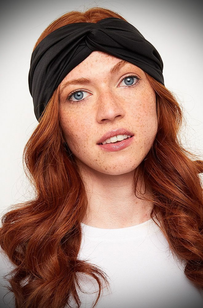 The Black Turban Style Headband effortlessly adds vintage style to your everyday look! Featuring a wide cut band with a knot detail.