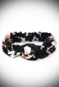 The Black Floral Turban Style Headband adds vintage style to your everyday look! Featuring a wide cut band with a knot detail in a romantic floral print.