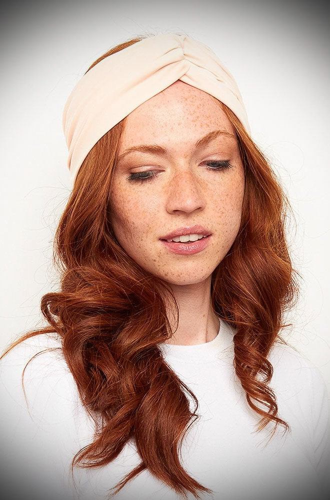 The Blush Turban Style Headband effortlessly adds vintage style to your everyday look! Featuring a wide cut band with a knot detail.