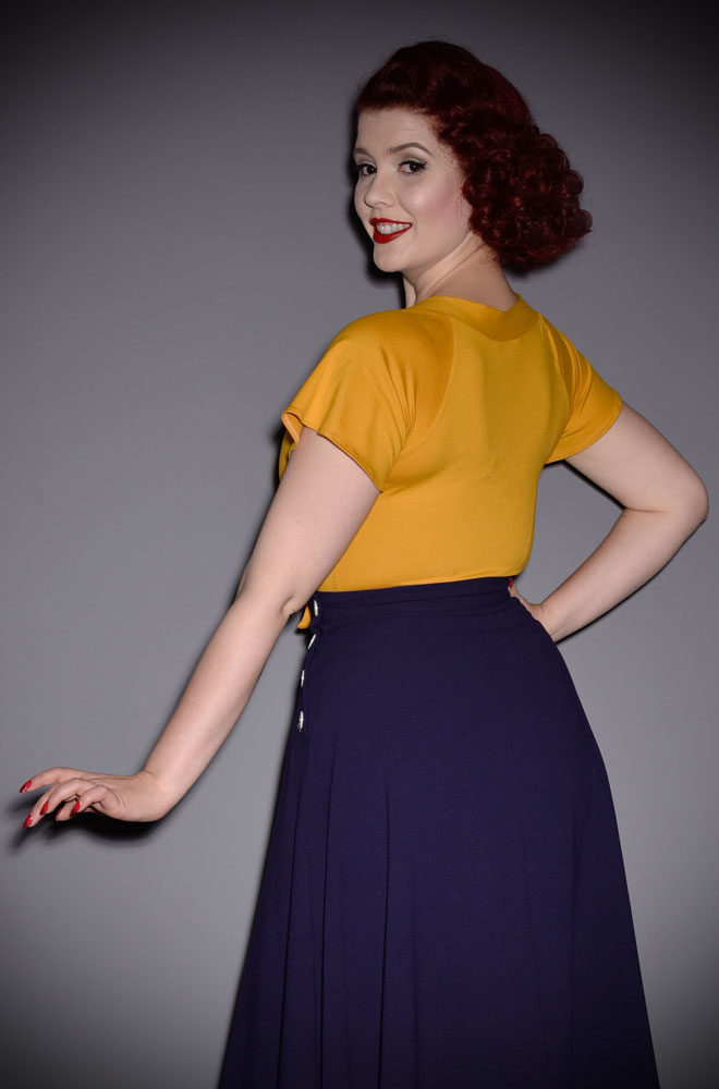 The Mustard Pretty Tie Top instantly adds some retro style to your everyday wardrobe. Perfect for pinups at DeadlyistheFemale.com