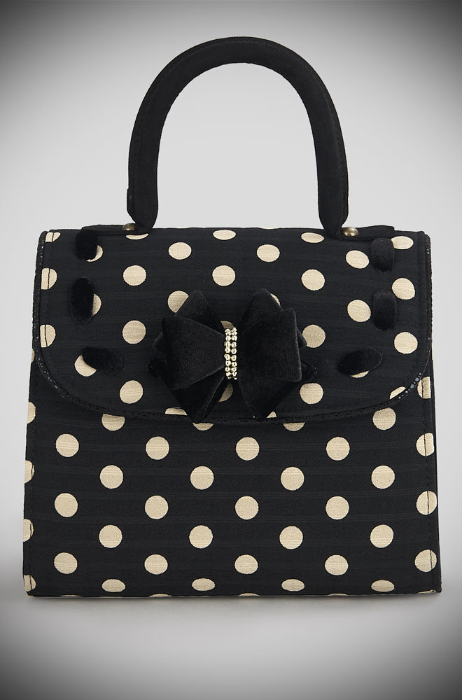 Introducing the Black Spotty Santiago bag. A black polka dot bag with ribbon trim and bags of vintage style charm by Ruby Shoo at Deadly is the Female.