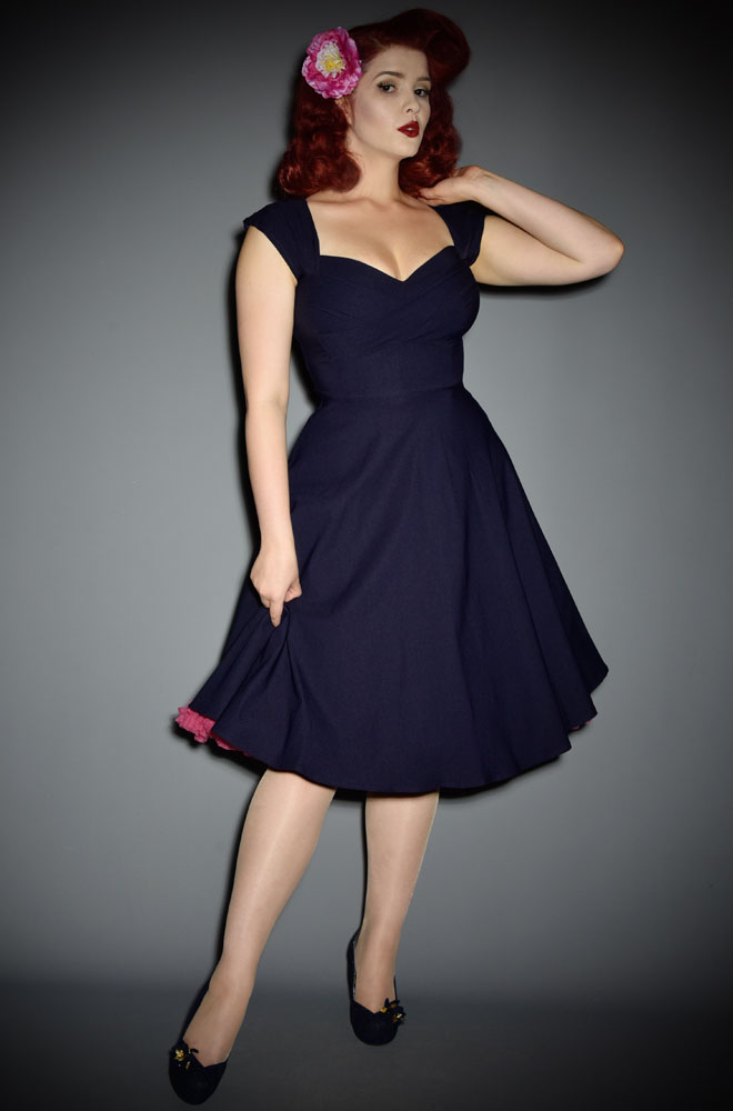 50's Navy Mad Style Swing Dress at Stop Staring! official UK stockists Deadly is the Female. A pin up dress in navy blue. High quality vintage reproduction.