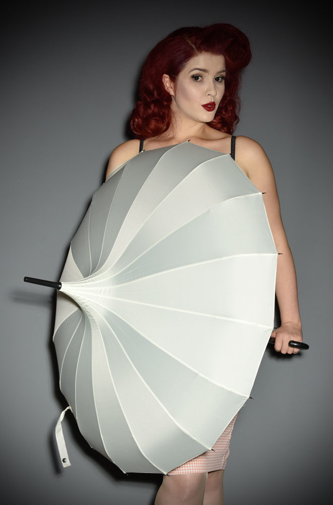 This full sizeIvory Pagoda Umbrella is striking and practical. A rainy day has never been so much fun!Available now at DeadlyistheFemale.com
