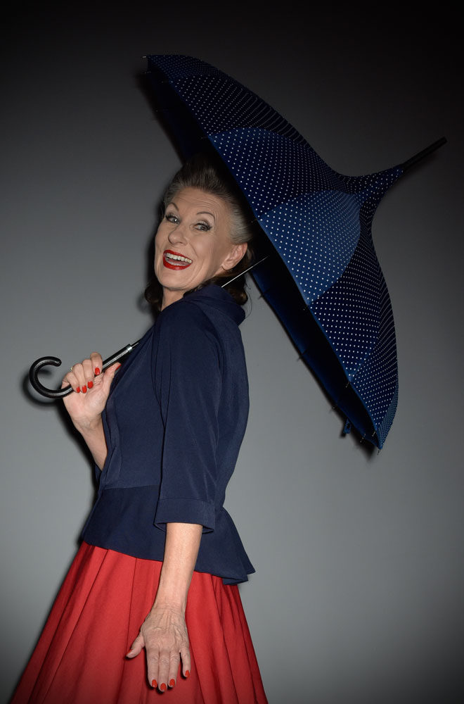 This full size Navy Polka Dot Pagoda Umbrella is striking and practical. A rainy day has never been so much fun! Available now at DeadlyistheFemale.com