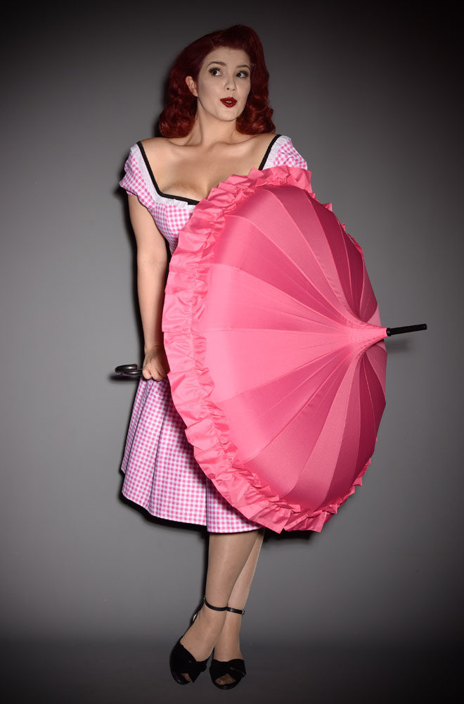 This full size Pink Ruffle Pagoda Umbrella is striking and practical. A rainy day has never been so much fun! Available now at DeadlyistheFemale.com