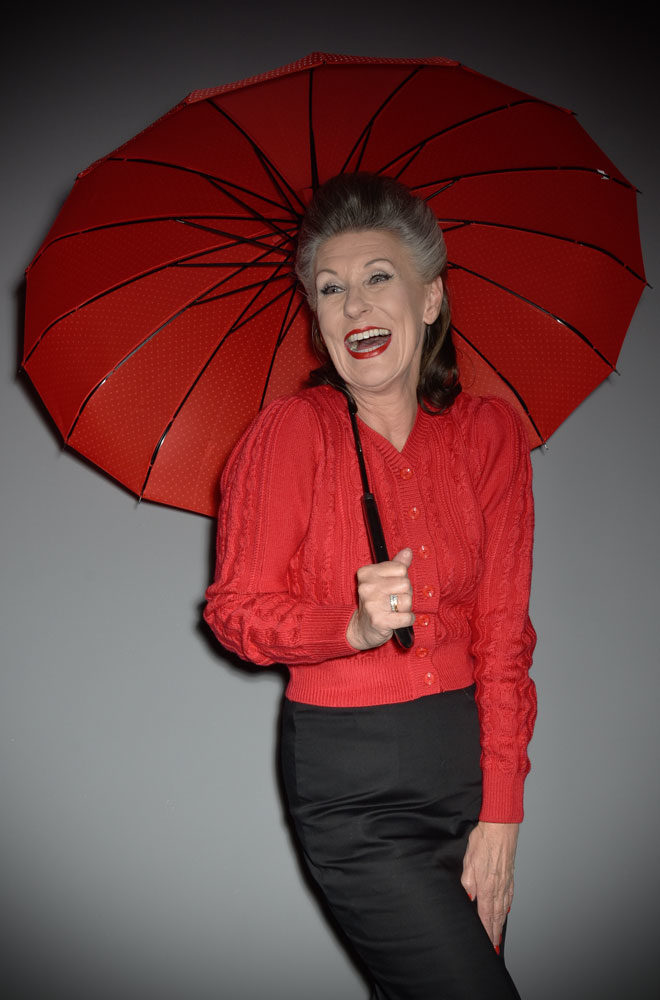 This full size Red Polka Dot Pagoda Umbrella is striking and practical. A rainy day has never been so much fun! Available now at DeadlyistheFemale.com
