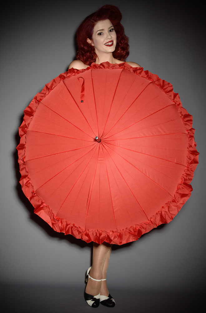 This full sizeRed Ruffle Pagoda Umbrella is striking and practical. A rainy day has never been so much fun!Available now at DeadlyistheFemale.com