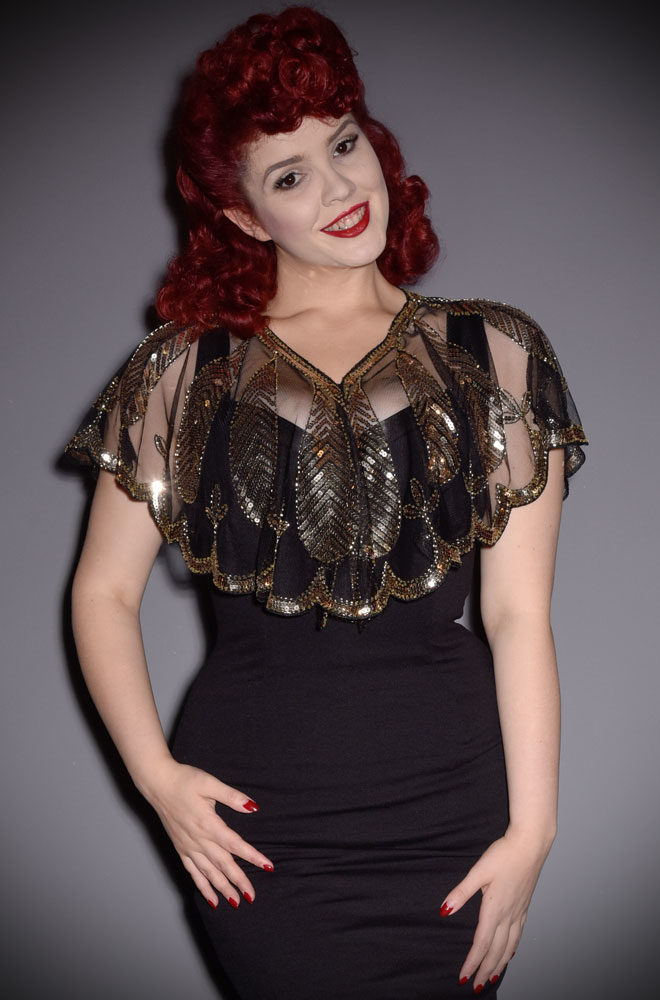 This1920's Black and Gold Capelet is the perfect accessory by Unique Vintage at official UK stockists, Deadly is the Female.