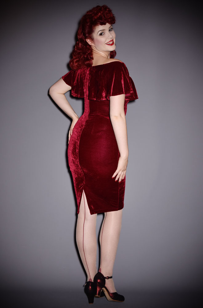 The Burgundy Velvet Sophia Dress is a vintage style wiggle dress by Unique Vintage at UK stockists, Deadly is the Female.