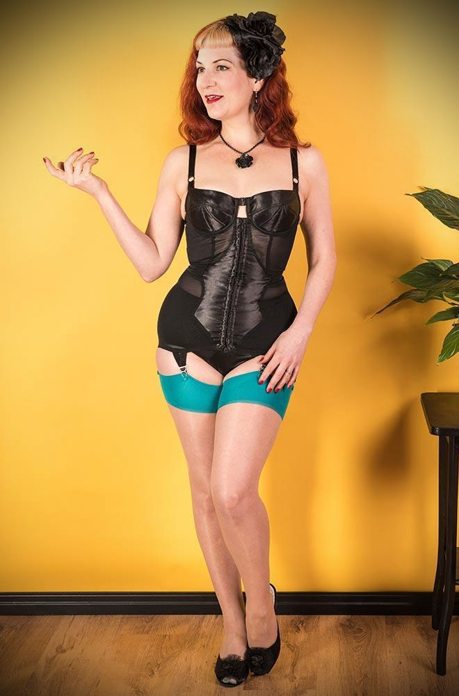 The Teal Glamour Seamed Stockings are sheer champagne nylons with a jewel tone blue seam. They add a little bit of glamour to any outfit.
