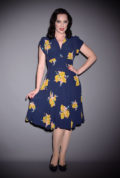 The Ava Tea Dress - a timeless 30s style dress in a beautiful vintage print. Featuring gold leaves on a navy background, this dress is effortlessly elegant.